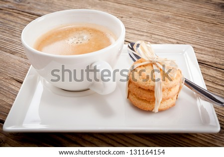 fresh aromatic coffee and cookies on wooden table