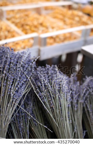 Fresh aromatic lavender bunches in front of trays of chanterelles at Viktualienmarkt daily farmer's market in Munich, Germany - stock photo