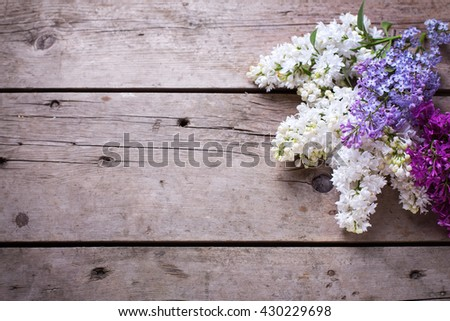 Fresh aromatic lilac flowers on vintage wooden planks. Selective focus. Place for text. Floral still life.