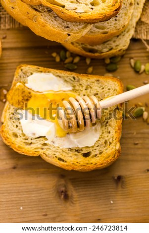 Fresh artisan sourdough seeded bread on the table. - stock photo