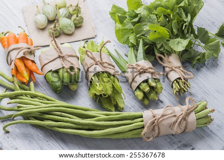 Fresh Asian cooking vegetables ingredients on wood background. - stock photo