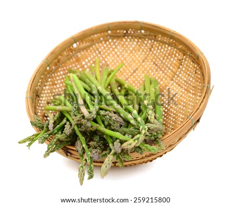fresh asparagus in basket on isolated white  - stock photo