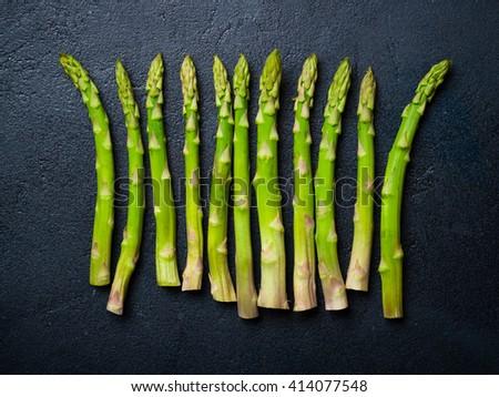 Fresh asparagus on a dark  background - stock photo