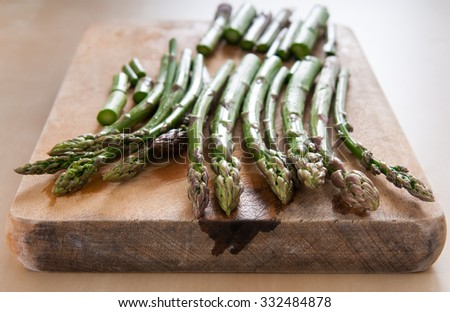 fresh asparagus on cutting board