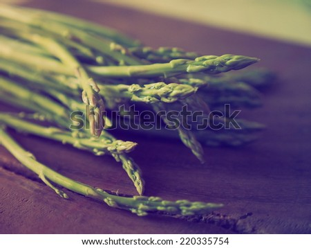 Fresh Asparagus  on the wood background vintage color - stock photo