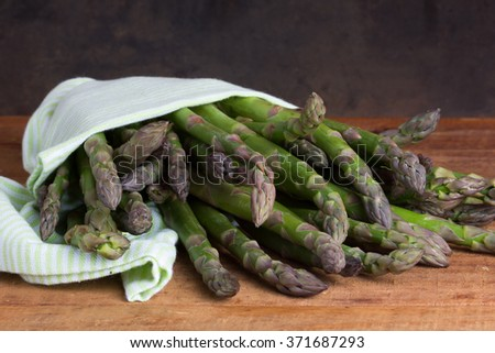 fresh asparagus on wooden background