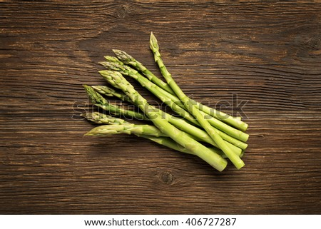 Fresh asparagus on wooden background overhead shoot