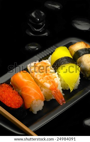 fresh assorted colorfull sushi plate over black