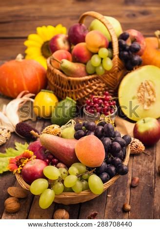 Fresh autumn fruits in the basket - stock photo