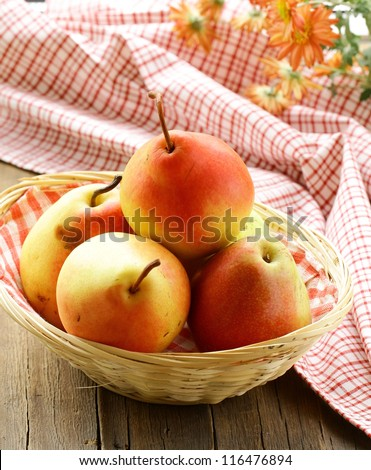 fresh autumn   juicy pear on a wooden table