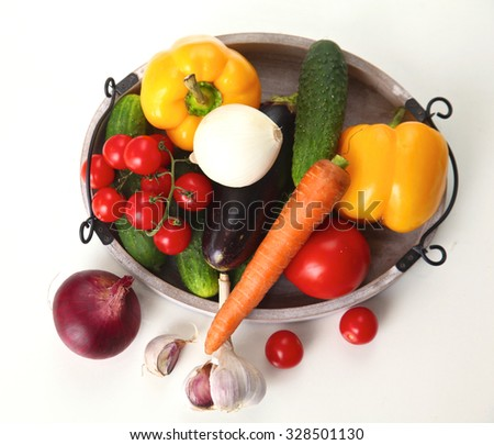 Fresh autumn vegetables on a white background.