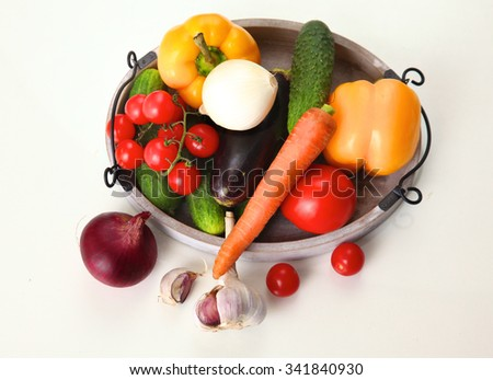 Fresh autumn vegetables on a white background