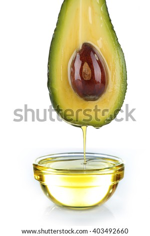 Fresh avocado and oil isolated on white background - stock photo
