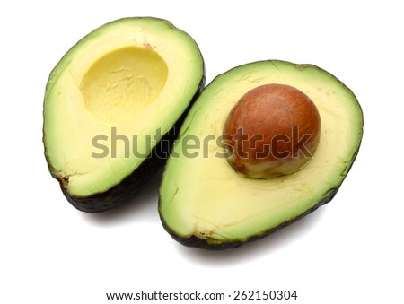 fresh avocado cut in half on white background  - stock photo