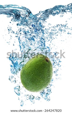 Fresh avocado dropped into water with splash isolated on white - stock photo