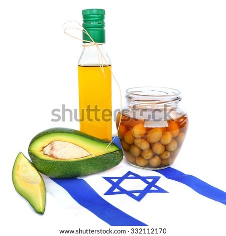 Fresh avocado fruit, olives, and olive oil with israeli national flag on a white background. Mediterranean agriculture israeli products - stock photo