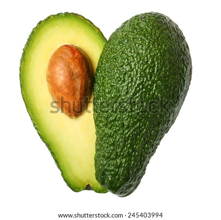Fresh avocado in the shape of a heart isolated on white background - stock photo