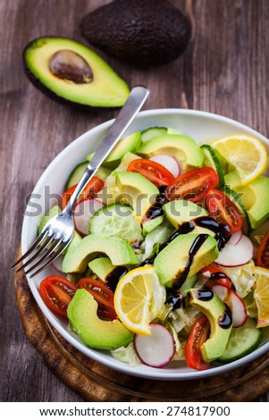 Fresh avocado salad with lemon - stock photo