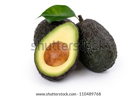 Fresh Avocados two whole and one halved isolated on white - stock photo