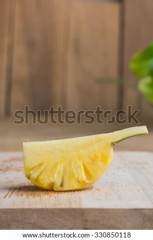 Fresh baby pineapple, small pineapple, Phu Lae pineapple - stock photo