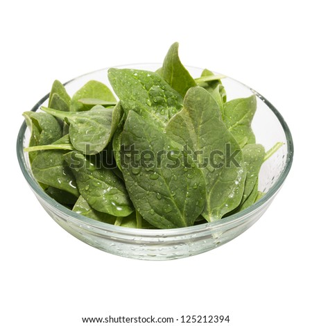 Fresh baby spinach in a glass bowl  (clipping path included)
