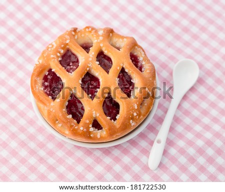 Fresh backed cherry pie on the table - stock photo