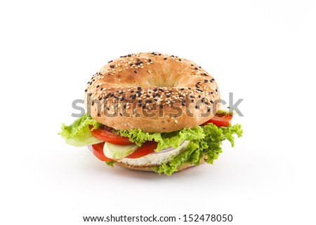 Fresh bagel sandwich isolated over white background - stock photo