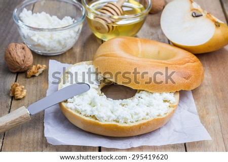 Fresh bagel with cottage cheese for breakfast. Concept of healthy eating. - stock photo