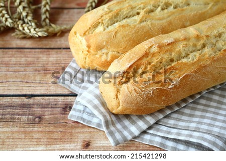 Fresh baguettes on the table, close-up - stock photo