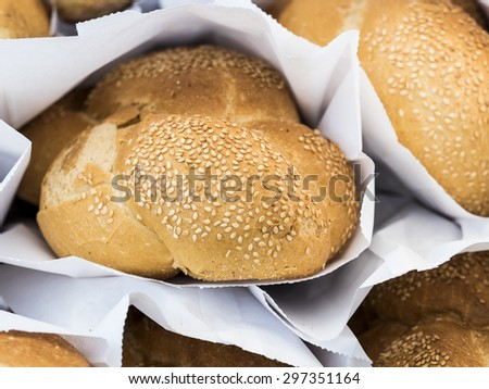 Fresh baguettes ready for sale at local market. - stock photo