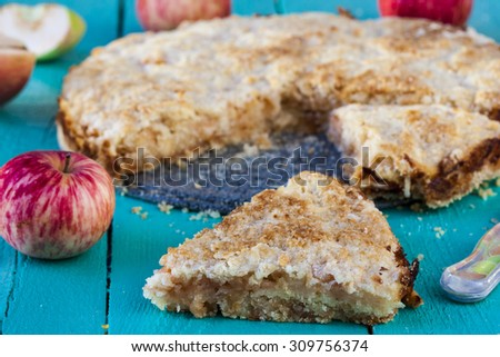 Fresh baked apple pie on wood background - stock photo
