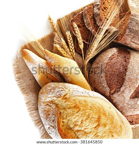 Fresh baked bread and wheat ears, isolated on white