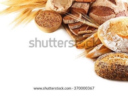 Fresh baked bread and wheat, isolated on white