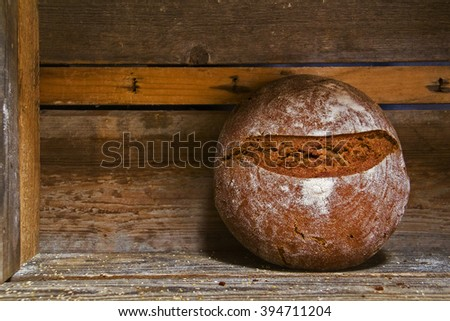 Fresh baked bread at wooden shelf