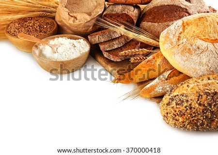 Fresh baked bread, flour and wheat ears, isolated on white