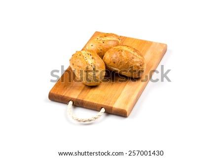 fresh baked bun bread isolated on white - stock photo