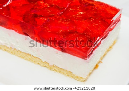 Fresh baked cake with strawberry jelly topping.