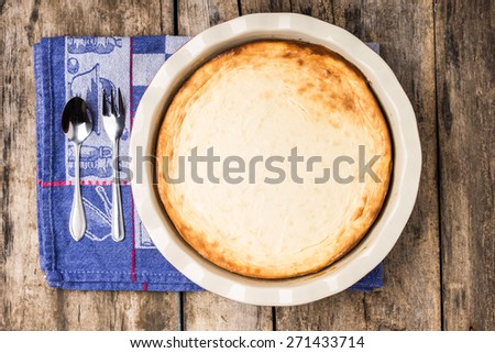 Fresh baked cheesecake on wooden table. Dessert cooking recipe background. Top view image - stock photo