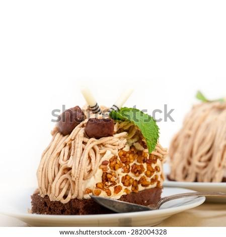 fresh baked chestnut cream cake dessert over rustic white wood table  - stock photo