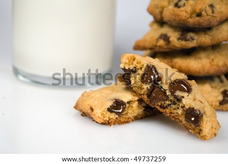 fresh-baked chocolate cookies and milk - stock photo