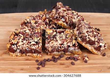 Fresh baked cookie bars made with chocolate chips and chopped pecans.