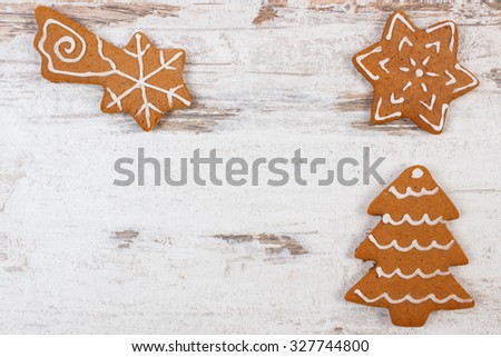 Fresh baked homemade decorated gingerbread and Christmas cookies on old white wooden background and copy space for text, christmas time - stock photo