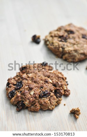 Fresh baked homemade oatmeal raisin cookies on woodem board (brown colour from sugar)