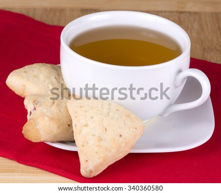 fresh baked mini  scones with tea - stock photo