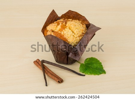 Fresh baked muffin on the wood background - stock photo