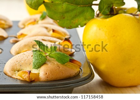 fresh baked muffins with quince and poppy seeds - stock photo