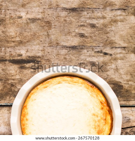 Fresh baked New York style cheesecake on wooden table with copy space. Top view image - stock photo
