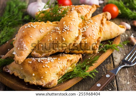 Fresh baked  pasties filled with meat and vegetables - stock photo