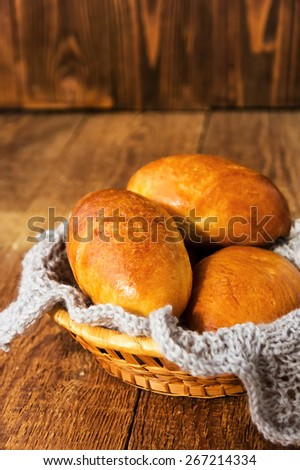 Fresh baked pasties on wooden table - stock photo