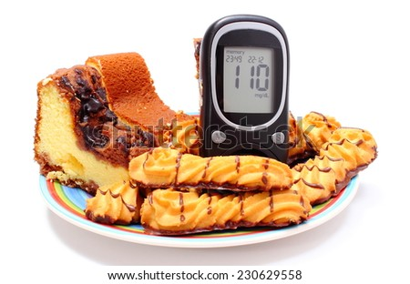 Fresh baked pastry and cakes on colorful plate and glucose meter, concept for diabetes and glucose level test. Isolated on white background - stock photo